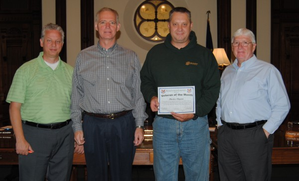 Chuck Dippon, an Army Ranger, was named October's Veteran of the Month at the Kosciusko County Commissioners meeting Tuesday. Pictured, from left, are Veterans Service Officer Rich Maron, Commissioner Brad Jackson, Dippon, and Commissioner Bob Conley; Commissioner Ron Truex was not present.