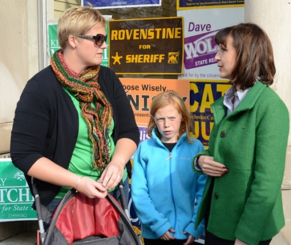 Allison McSherry takes a moment to speak with Kelly Mitchell, candidate for treasurer of state. Maddie McSherry is shown in the middle. (Photo by Deb Patterson)