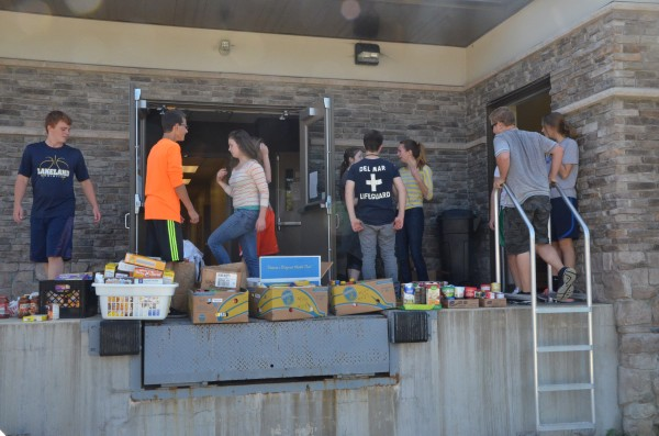 LCA students take a moment to process incoming donations.  (Photo by Alyssa Richardson)
