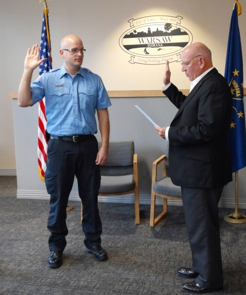 Troy Knefelkamp takes the oath of office from Charles Smith during the regular board of public works and safety meeting today.