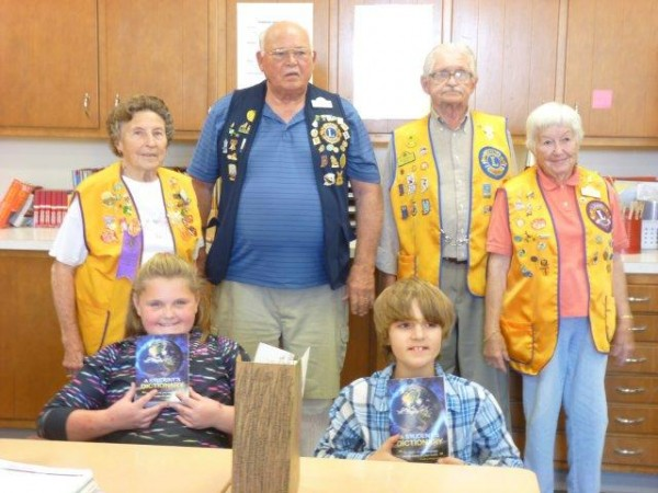 Shown with their new dictionaries are students Kylie Keirn and Orion Fancil. Lions members standing in back are Betty Rose Stahl, Bob Tenney and Mr. and Mrs. Ed Nordstrom. (Photo provided)