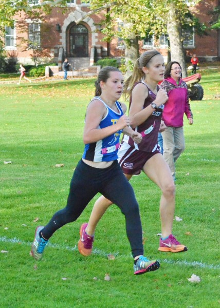 Triton's Baylee McIntire (left) edges out CMA's Saga Brismar near the finish line in Saturday's race. McIntire qualified for the regional with a time of 21:49.6.
