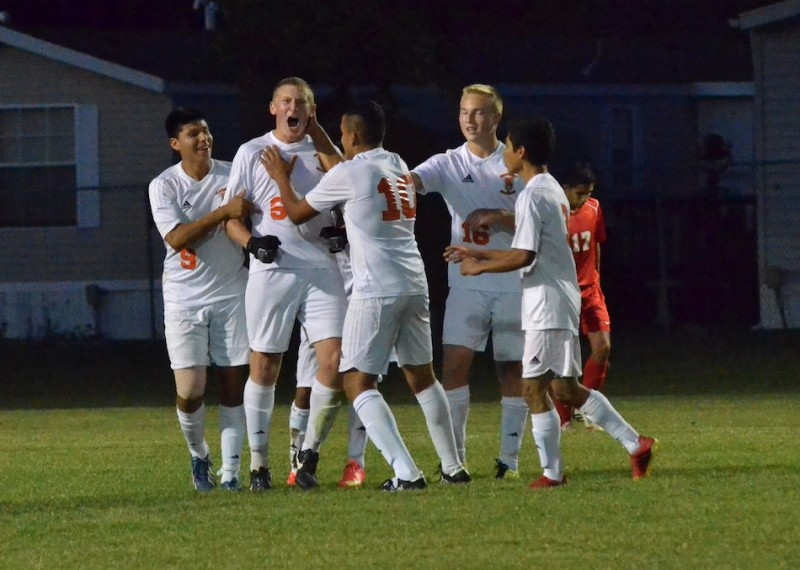 Sam Allbritten (6) celebrates after making a goal to tie things up in the first half. (Photos by Nick Goralczyk)