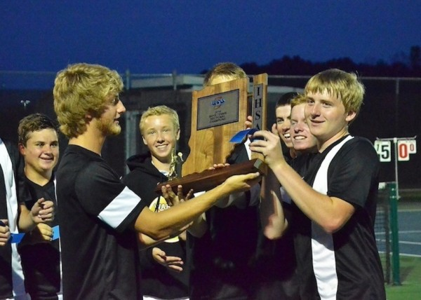 The Warsaw boys tennis team, shown with the sectional trophy, meets Plymouth in a regional showdown Tuesday (File photo by Nick Goralczyk)