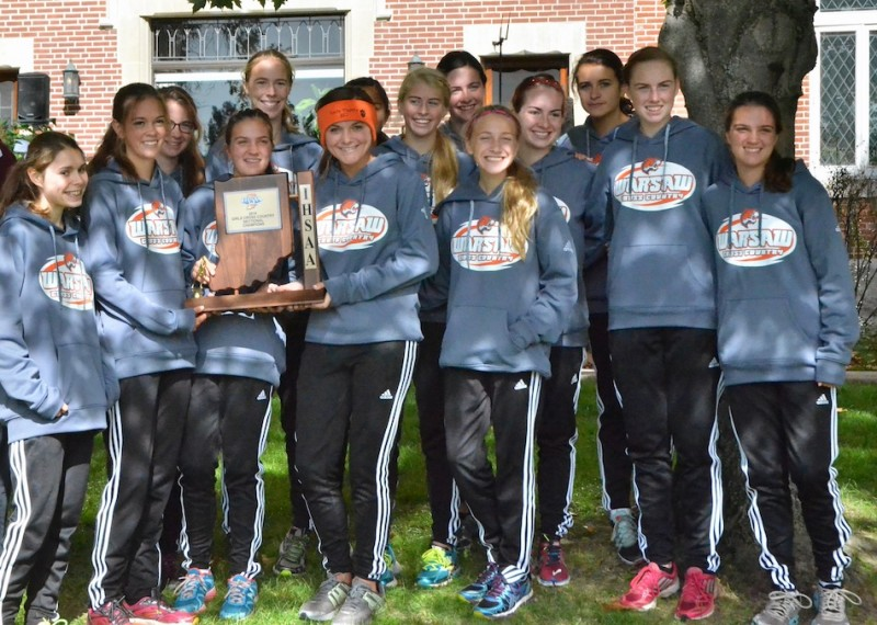 The Warsaw girls cross country team poses with its sectional championship trophy for the fourth consecutive year.