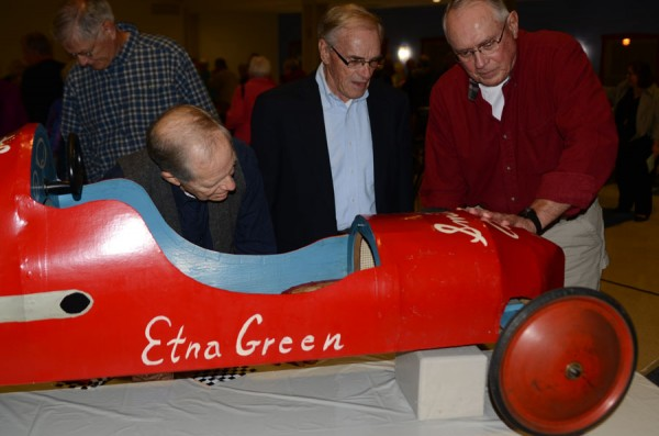 Harry Gigous and Bill Huffer talk with Larry Shively on the design of his soapbox derby car he raced in 1955 and 1956. (Photo by Deb Patterson)