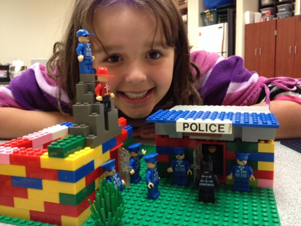 Sophie Gernand beams with pride over her LEGO police station that she built during LEGO Club.