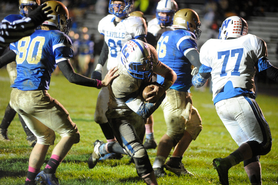 LaVille running back Ben Norton smashes through the Triton defense for a touchdown in the third quarter of LaVille's 15-0 win Friday night. (Photos by Mike Deak)