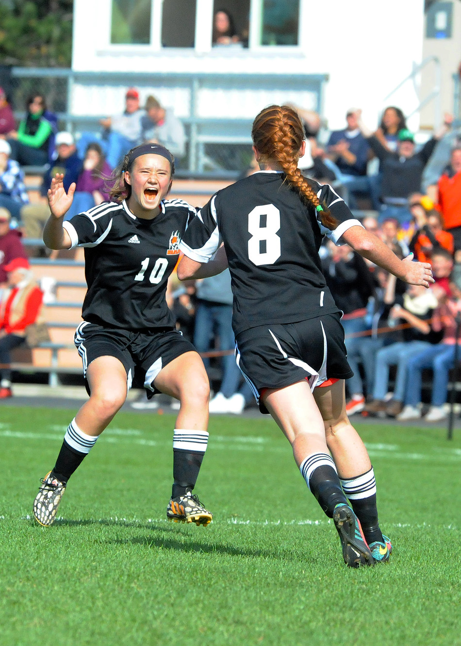 Warsaw's dynamic duo of Elizabeth Van Wormer (10) and Brooklyn Jackson have done a lot of celebrating this postseason.