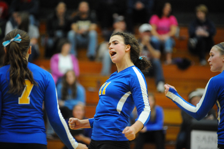 Triton's Becca Kennedy celebrates a point Saturday in the Culver Volleyball Sectional. Kennedy led Triton with eight kills in the Lady Trojans' 3-0 win against Oregon- Davis in the championship. (Photo by Mike Deak)