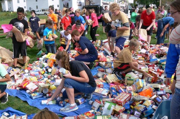 Students pick through donations to sort food items into groups.  (photo provided by Scott Wiley)