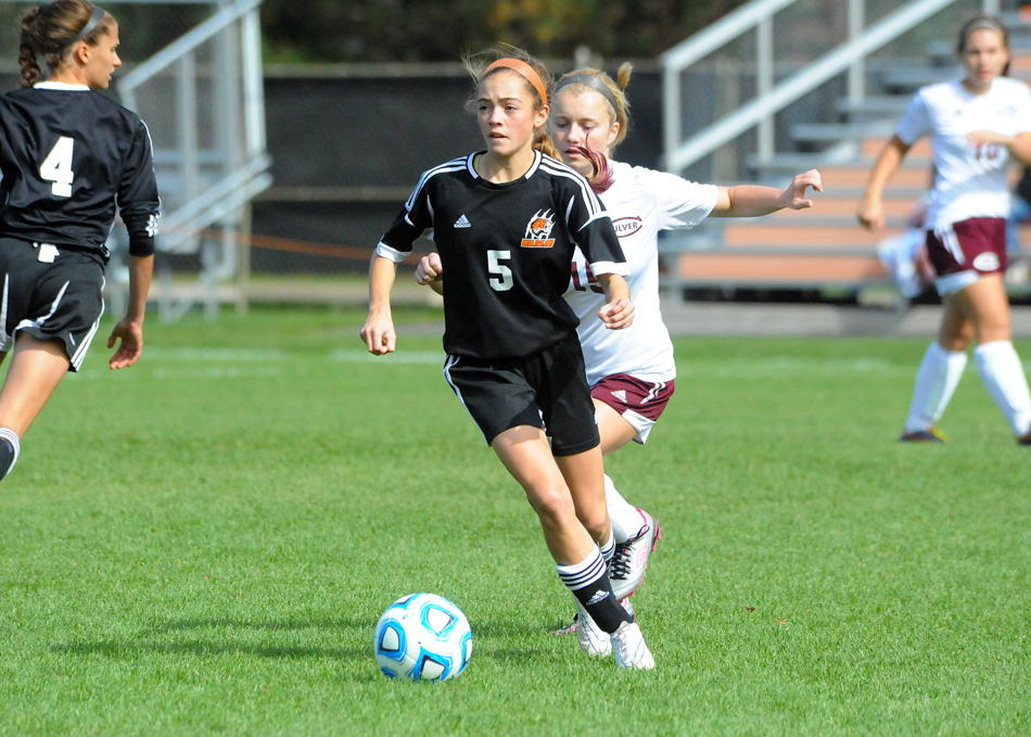 Warsaw freshman Brenna Shipley has given the Lady Tigers surprising stability at midfield. (Photos by Mike Deak)