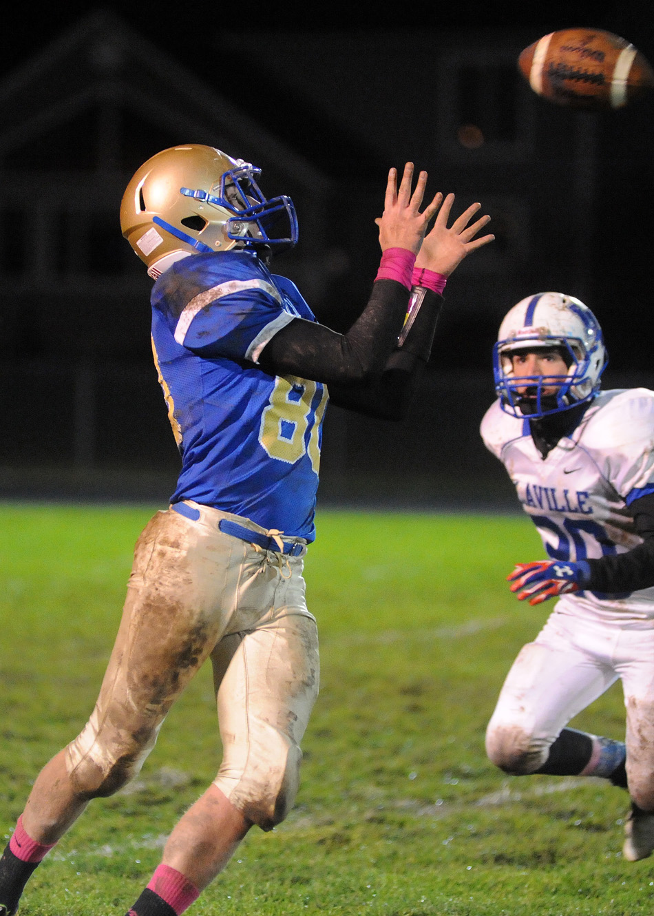 Triton wide receiver Tristan Hunsberger hauls in a catch, one of just four completions by either team all night.