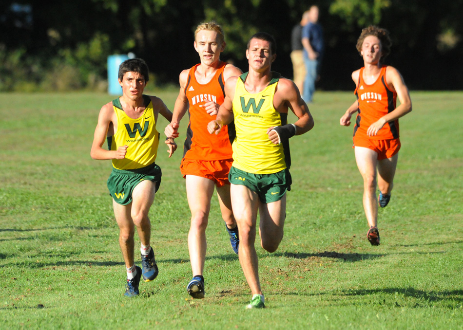 Wawasee's Troy Carolus (left) and Zach Cockrill run with Warsaw's Daniel Messenger during the NLC dual in September.