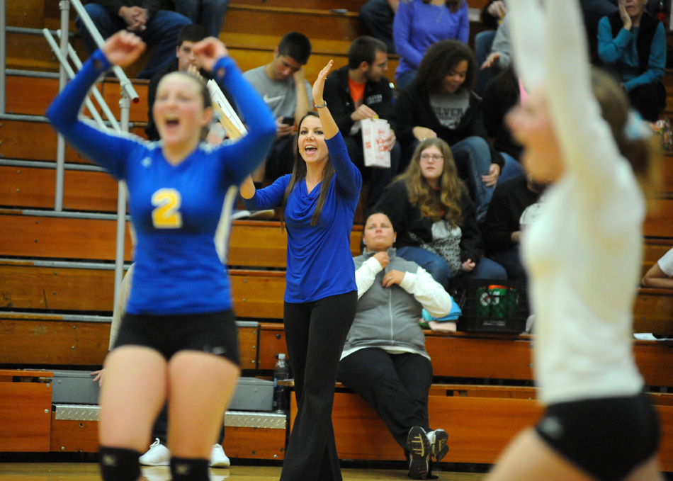 Triton head coach Samantha Willsey celebrates with Krystal Sellers and Quinn Downing at the Culver Volleyball Sectional. (Photo by Mike Deak)
