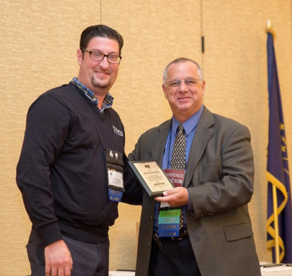 Metzger Property Services is presented with awards at the IAA conference.