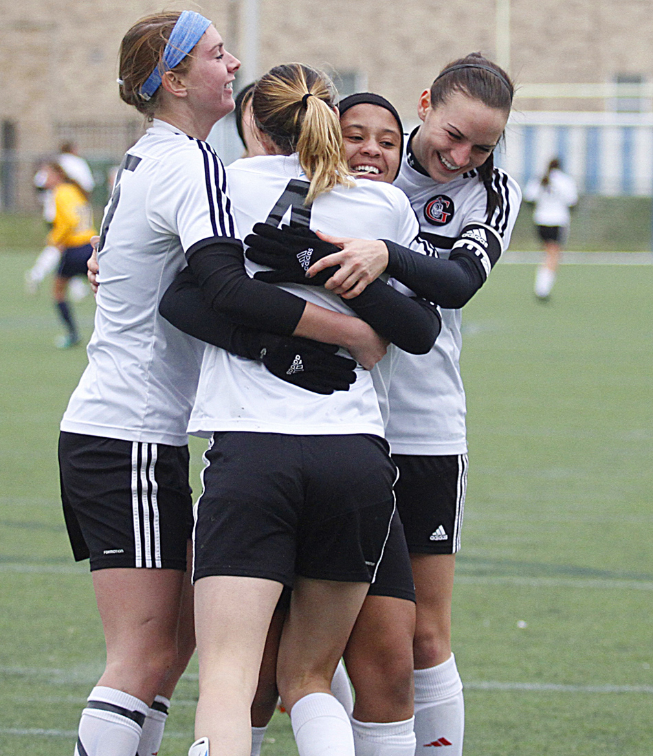 The Grace College women's soccer team celebrates Mallory Rondeau's game-winning goal on Saturday. From left are Meredith Hollar, Mallory Rondeau, Kaitlyn Hayes and Holly Bennett. (Photo provided by the Grace College Sports Information Department)
