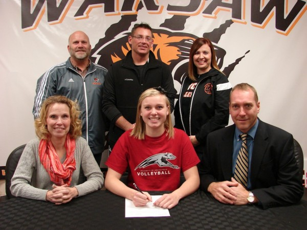 WCHS senior volleyball standout Katie Voelz signs to play at the University of Indianapolis. Voelz is shown above with her parents Gina and Brad. In back are WCHS Athletic Director Dave Anson, WCHS volleyball coach Mike Howard and WCHS volleyball assistant coach Chandra Hepler (Photo provided)