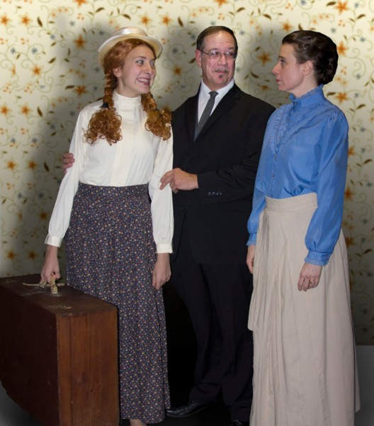 """Molly Dashiell of Valparaiso (left) stars as Anne Shirley in """"Anne of Green Gables"""", an orphan girl who finds her true family on Prince Edward Island with Mathew and Marilla Cuthbert, played by Ken Siegfried of Michigan City and Deb Dashiell. Showing  at Footlight Theatre the first two weekends of December."""