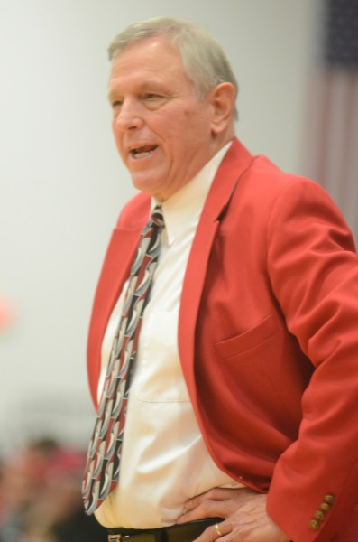 Jim Kessler instructs his team during his historic win Friday night at Grace College.