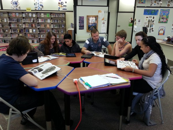 Mr. Lucht's class study nonfiction materials at the Gateway Library.  (Alyssa Richardson)