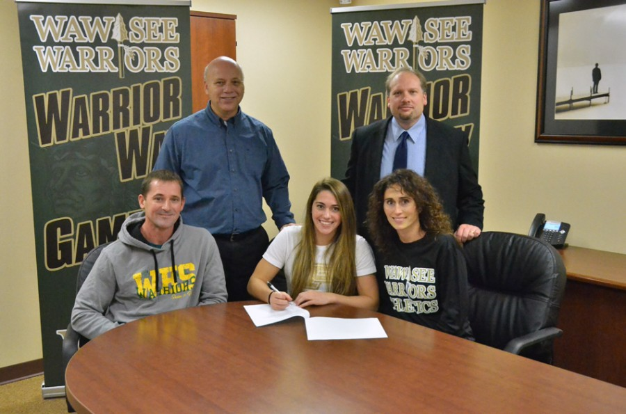 Bre Robinson along with her parents and school officials. (Photo by Nick Goralczyk)