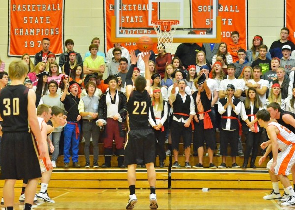 Justin Bachelder tries to avoid scurvy while shooting towards the Warsaw students sectiona on pirate night.