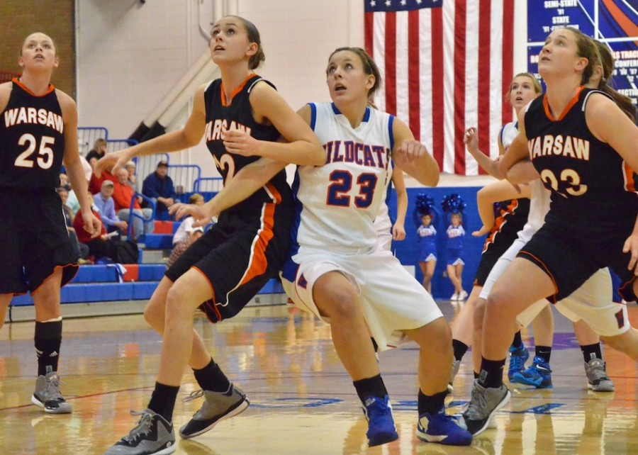 Dayton Groninger of Warsaw and Aly Nicodemus of Whitko battle for a rebound.