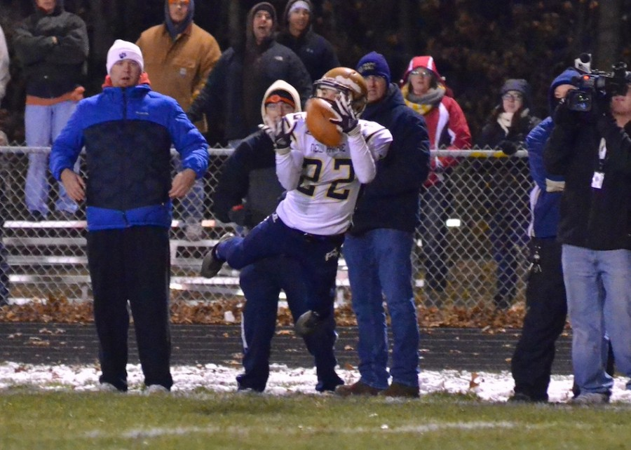 Drake Dierdorf makes a spectacular diving grab for the Cougars during the fourth quarter of Friday's semi-state championship game. (Photos by Nick Goralczyk)