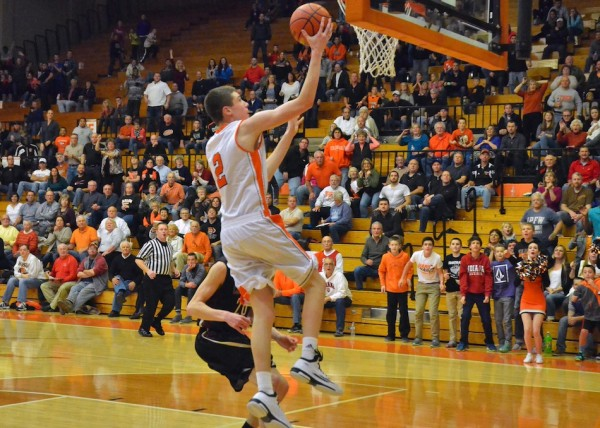 Kyle Mangas lays in two points after getting a steal for Warsaw.