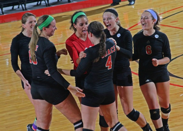 The Grace College volleyball team celebrates during a home win over Goshen College Wednesday night (Photo provided by the Grace College Sports Information Department)