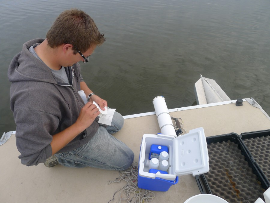 Grace College undergraduate student Logan Gilbert labels water samples from Winona Lake to be analyzed for blue-green algae and it's microcystin toxin. (Photo Provided)