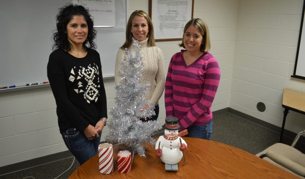 From left Steffanie Stookey, Shauna Young and Kristen Firestone of the Wawasee Middle School PTO are busy preparing for the annual craft bazaar at the school. They are shown with a few typical items to be found at the bazaar.
