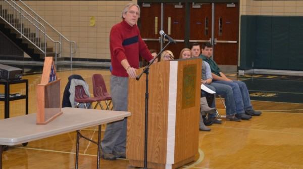 """Pat Park, a retired Naval officer, was the guest speaker at Tuesday's Veterans Day program at Wawasee High School. He often referred to his """"shadow box"""" on the left."""