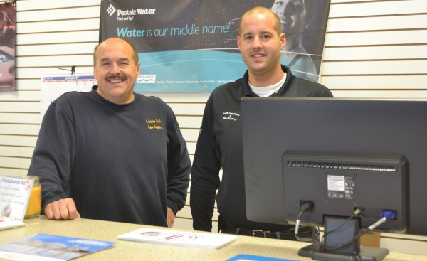 "Leisure Pool & Spa Supply owner Tim Yoder, left, and his son, Mark, are excited about the growth their business has experienced in its 25 years. Yoder stated, ""We've been very blessed."""