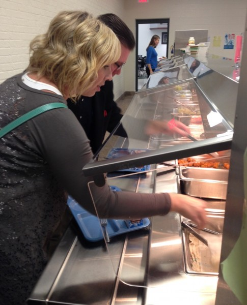 Syracuse-Wawasee Chamber of Commerce board members enjoyed a tour of Wawasee High School during their regular board meeting Nov. 5. The tour also included a lunch. Pictured is Tricia Small, a chamber board member, trying some of the food offered by WHS.