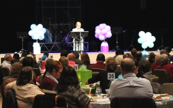 Cardinal Board Chair Peggy Michel of Lake City Bank welcomes guests to the 9th Annual Cardinal Call Fundraising Luncheon at Warsaw Community Church.