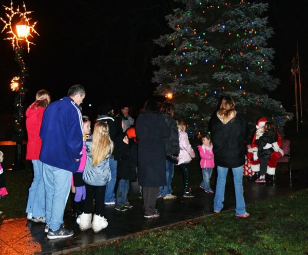A long line of youngsters wait to tell Santa their wish list for Christmas.