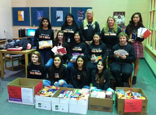 The Dream Council at Warsaw Community High School with collected snacks and drinks to be sent to troops.