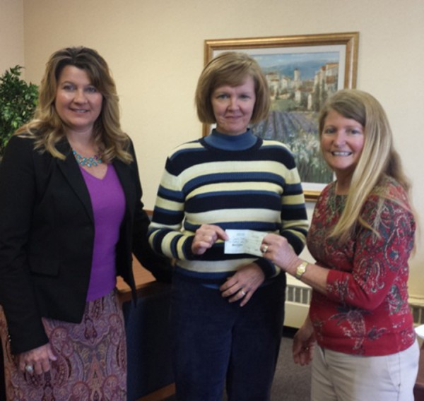 Pictured are Women of Today reps Kathy Siri (l) and Deb Webb (r) presenting the donation check to Cardinal Services CEO, Jane Wear (center).