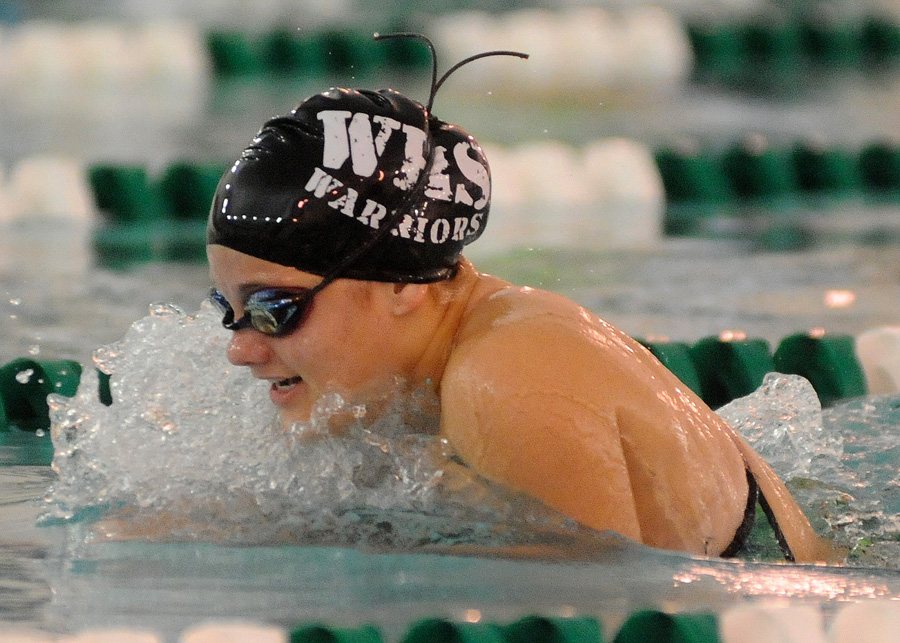 Shelby Adams of Wawasee works through the breaststroke portion of the medley relay for Wawasee's winning relay.
