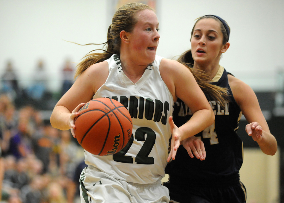 Wawasee's Hannah Haines dribbles around Fairfield's Alyssa Zook.