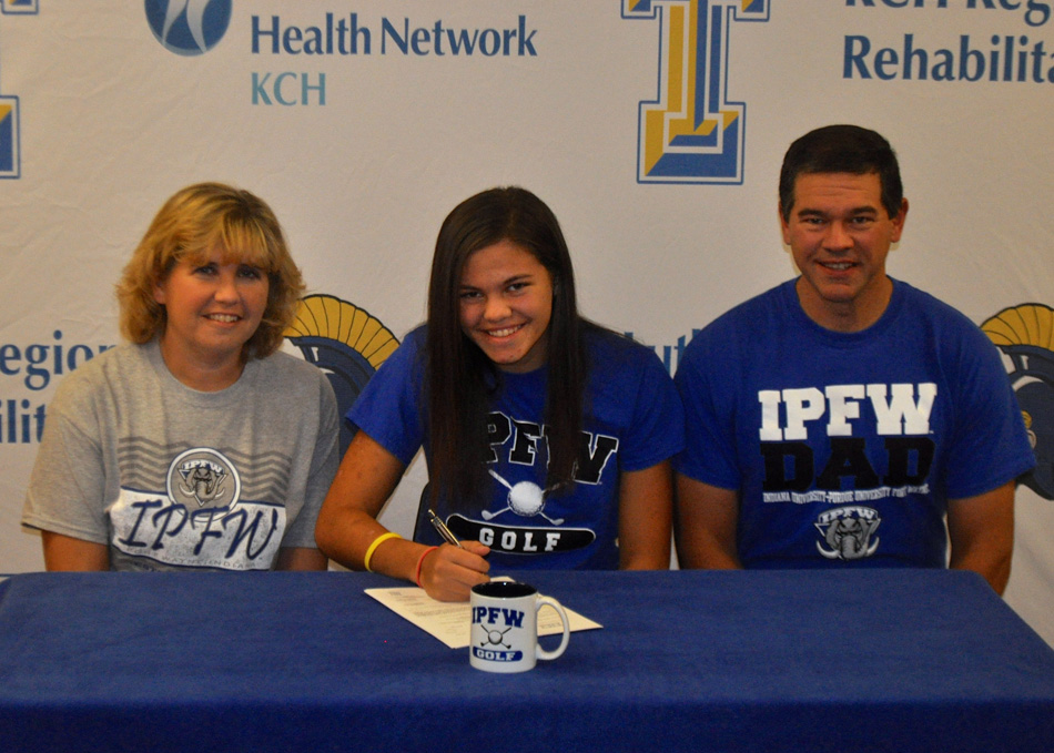 Triton High School senior Hannah Jennings has signed a national letter of intent to continue her golf career at IPFW. Seated with Jennings are parents Staci and Scott Jennings. (Photo provided by the THS athletic department)