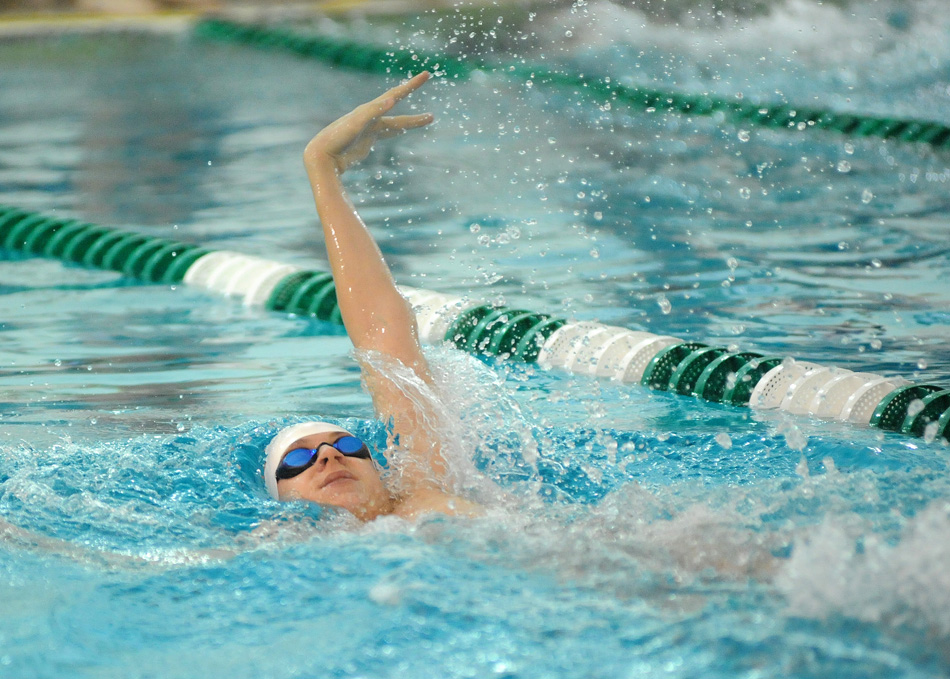 Josh Cardin of Warsaw swims the backstroke leg of the medley relay against Wawasee.