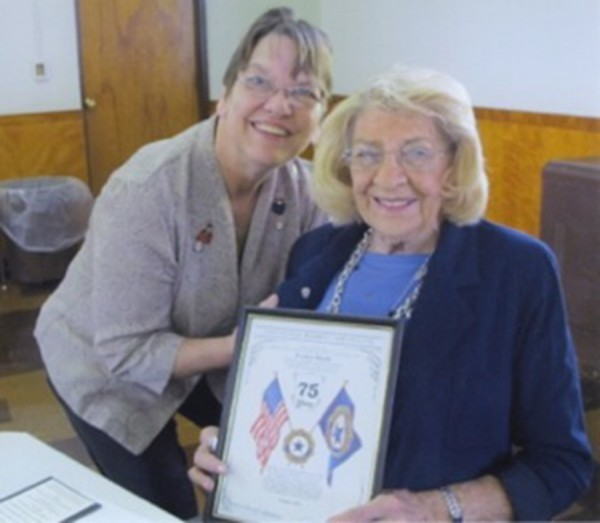 Pictured are Warsaw Auxiliary president Kathy Snell, left, presenting the pin and plaque to Evelyn Marsh, right. (Photo provided)