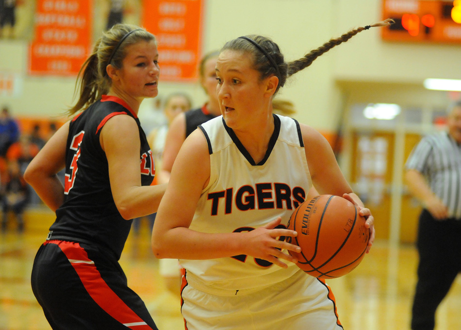 Warsaw's Pam Miller looks to move around Fort Wayne Luers' Kayla Knapke Tuesday night. (Photos by Mike Deak)