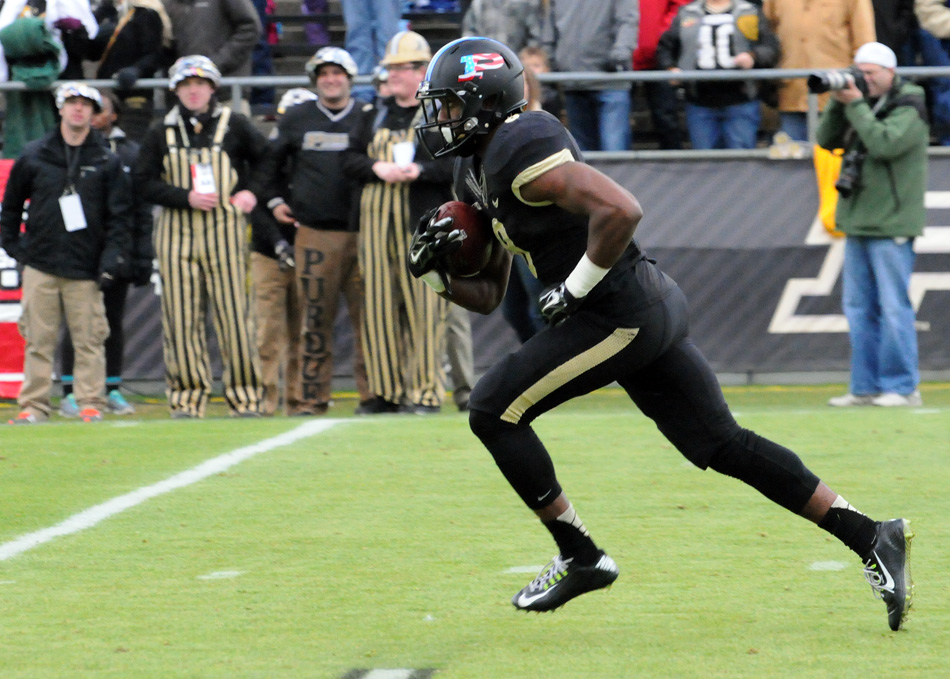 Purdue's Raheem Mostert takes a kick-off upfield against Wisconsin.