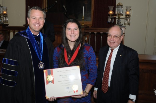 Molly Elizabeth Studer, Center. Standing with Studer are Judson University President Gene C. Crume, Jr., left, and Lincoln Academy Vice Chancellor William Bennett.