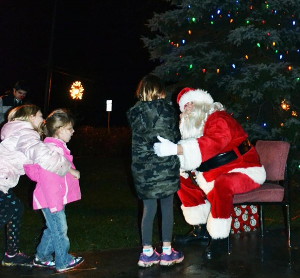 This youngster takes the opportunity to visit with Santa.