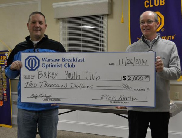 Baker Youth Club Executive Director Tracy Furnival accepts a $2,000 check from Rick Kerlin, Warsaw Breakfast Optimist Club. (Photo provided)